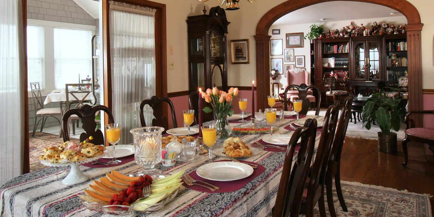 Breakfast being served in the dining room and the adjoining sun drenched sun porch.